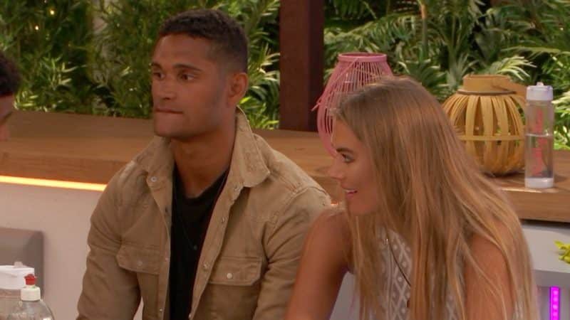 Arabella and Danny listen to the group